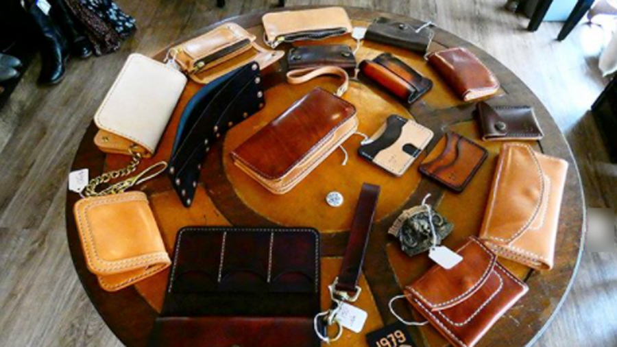 A table full of leather wallets and purses