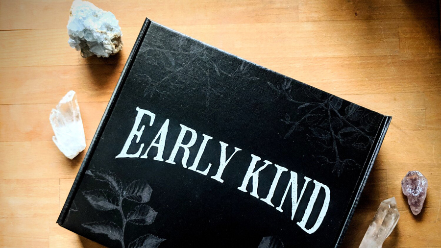 "A black box with the words ""Early Kind."" There are crystals on the table next to the box"