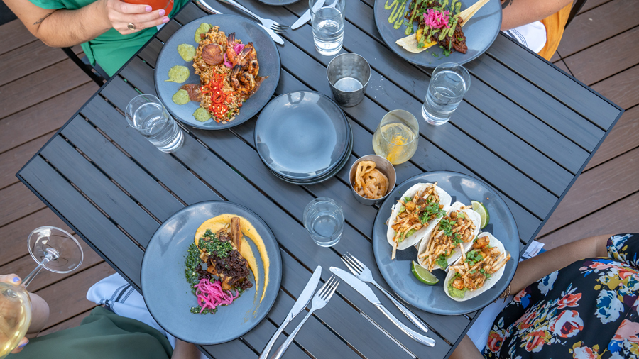 A table with plates of food from Livery