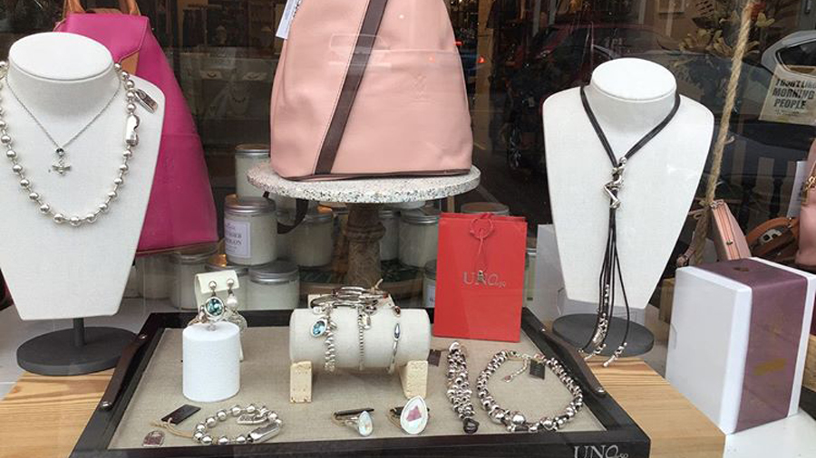 a window display with fine jewelry and other gifts