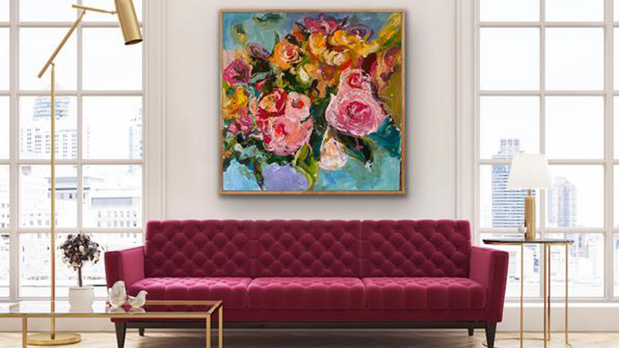 a painting of flowers hanging on a wall