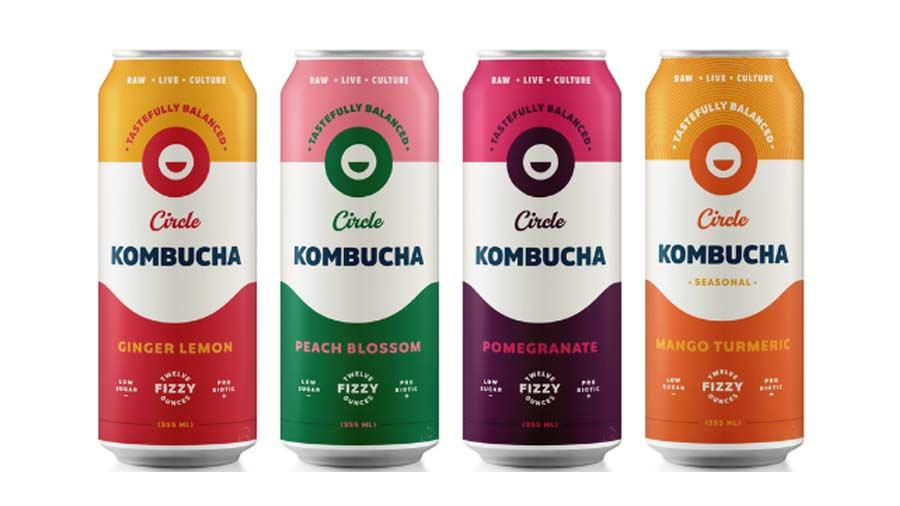 Four cans of Circle Kombucha