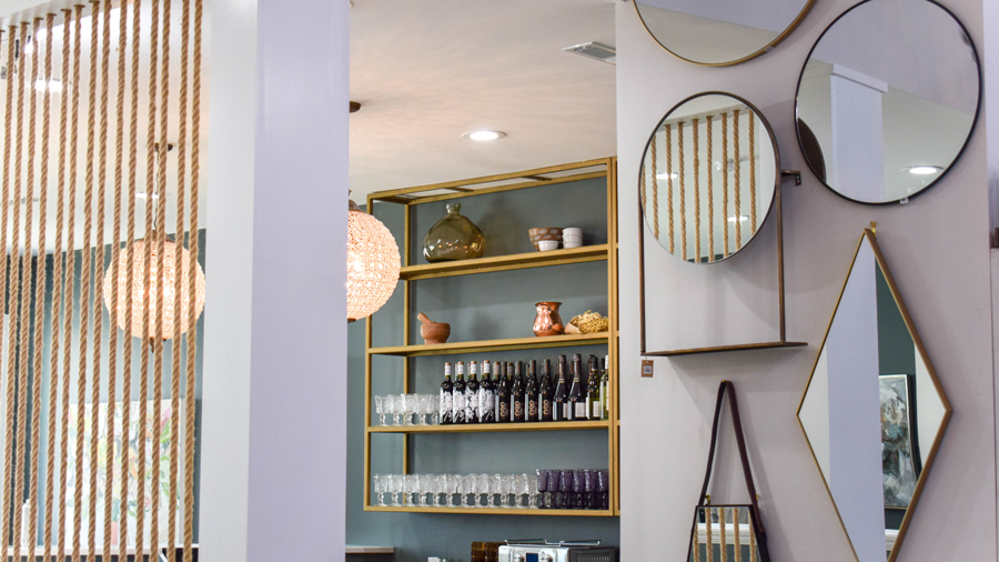 An indoor shop with gilded mirrors and home décor