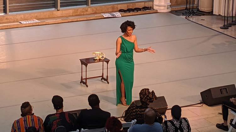 Art & Soul speaker on stage, green dress