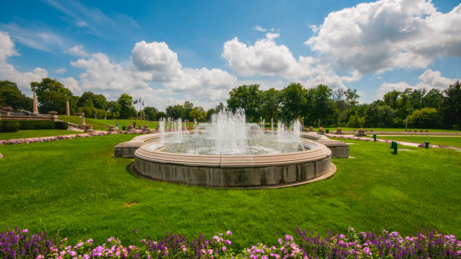 fountain underneath a blue sky