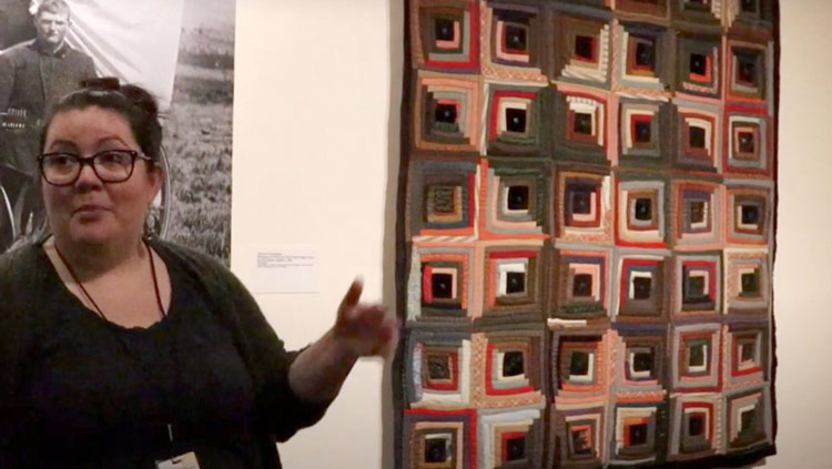 Women showing a quilt at the Eiteljorg Museum