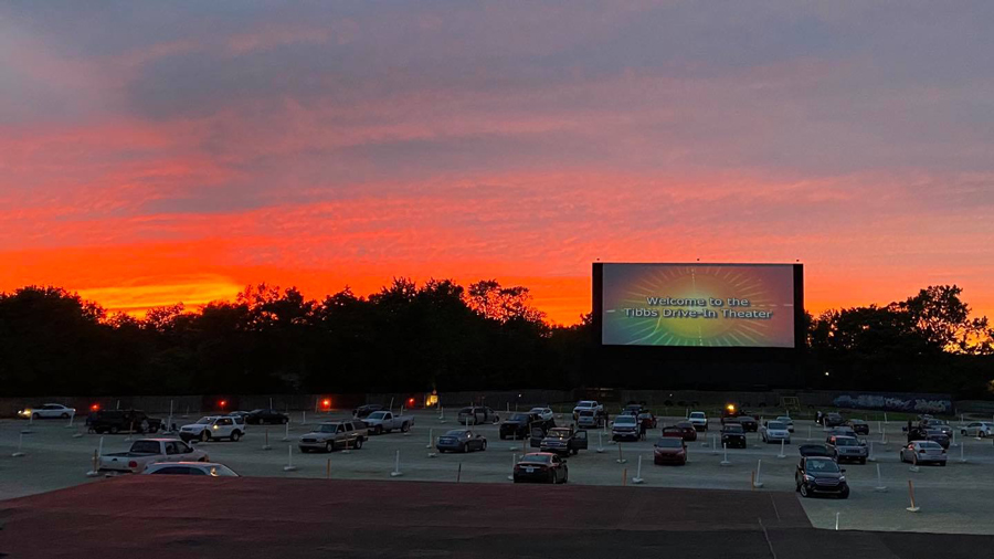 Sunset sky with the drive-in theatre with cars