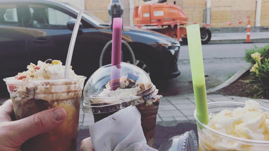three milkshakes with straws