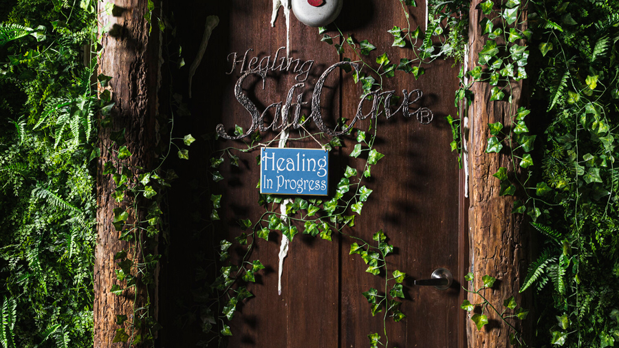 "Salt Cave door, sign reads ""Healing in Progress"" and ""Healing Salt Cave"""