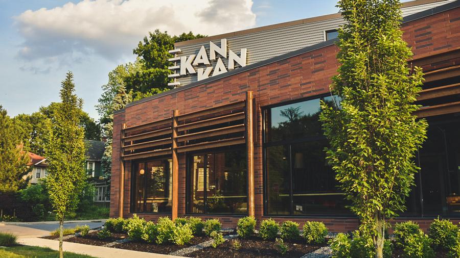"""Kan Kan outside, sign reads """"Kan Kan"""""""