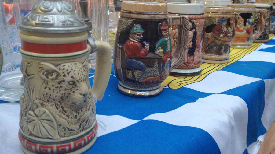 A table holding a collection of steins