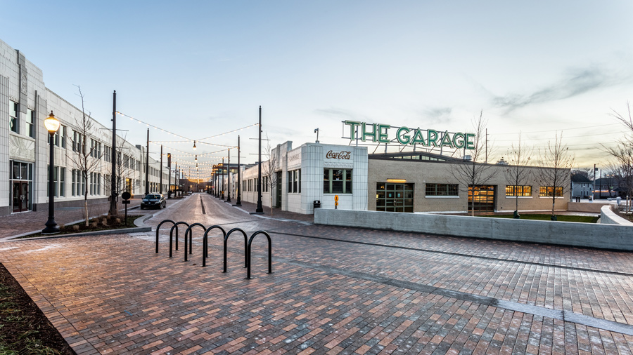"""The Garage exterior. Large brick building with sign """"The Garage"""""""