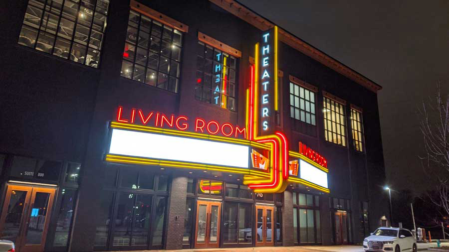 """Large building with sign saying """"Living Room Theaters"""""""