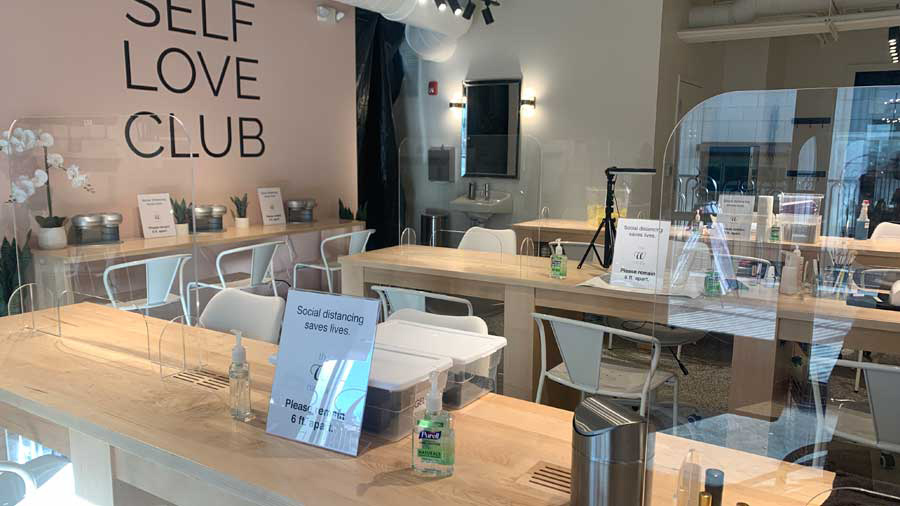 "Nail salon. Wall says ""Self Love Club"""